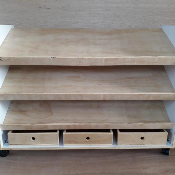 Puzzle shelf with storage boxes